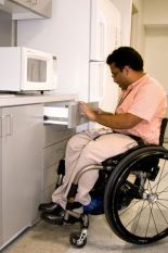 man opening drawer in wheelchair.jpg